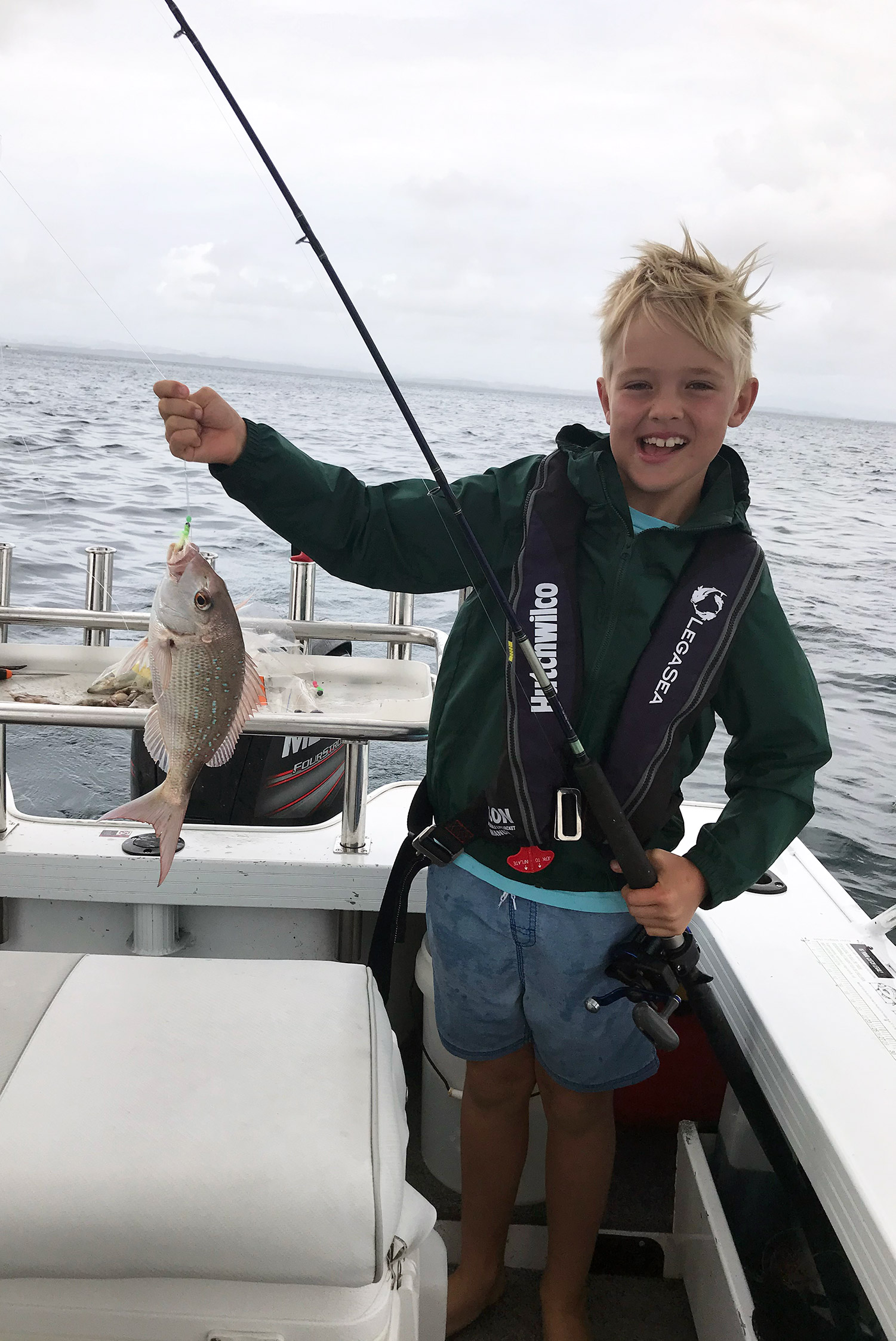 A child fishing for snapper in New Zealand.